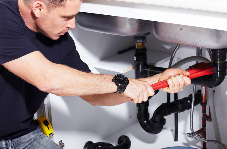 plumber fixing plumbing problems at a home in Chiswick NSW