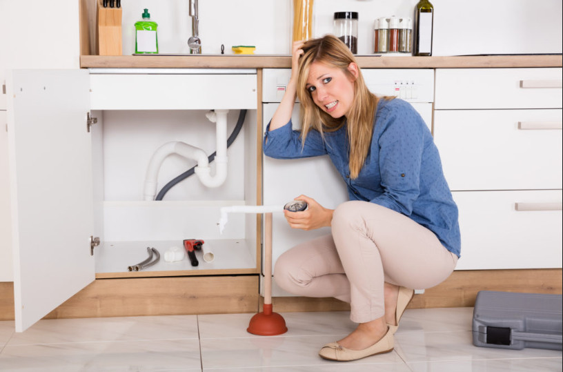 woman fixing plumbeing problem by doing it herself